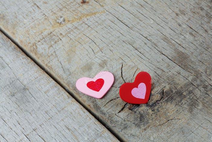Hearts on wooden floor