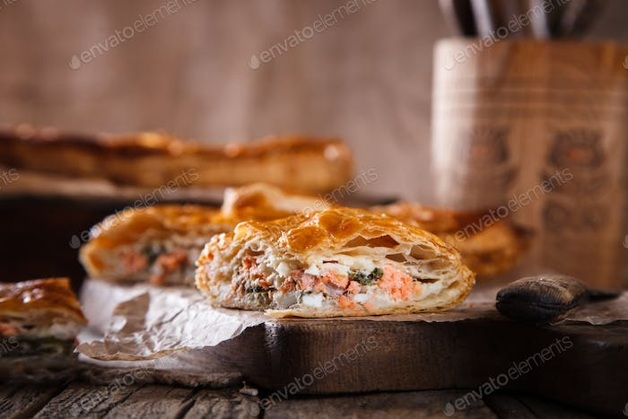 Cake of puff pastry with savory stuffing ,with salmon and spinach