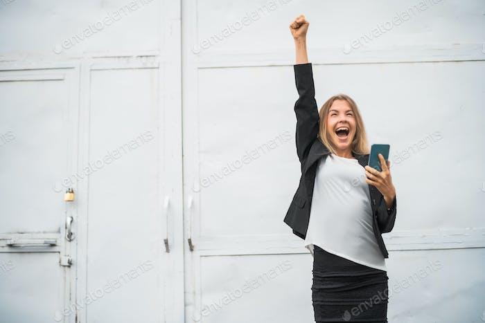 Ecstatic businesswoman