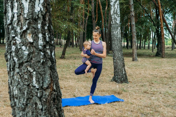Safe gym or exercise class outdoor. Family staying fit by exercising together in parks. Mother