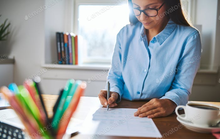 Young businesswoman busy writing notes