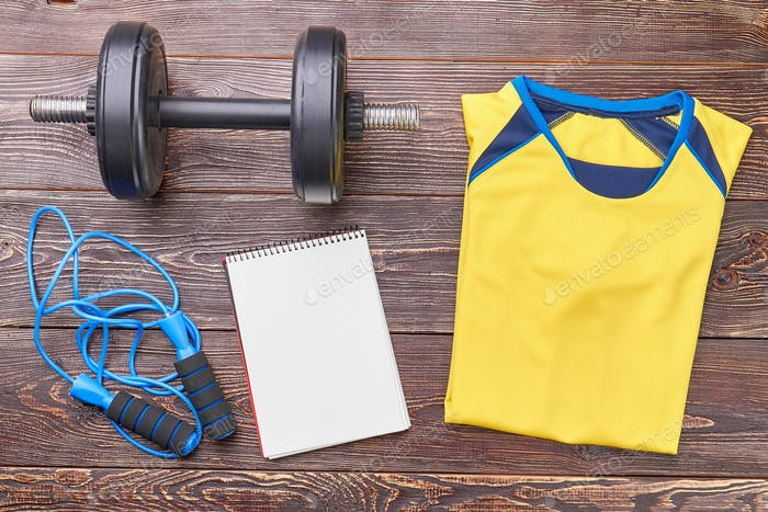 Jumping rope, dumbbell, notebook, t-shirt