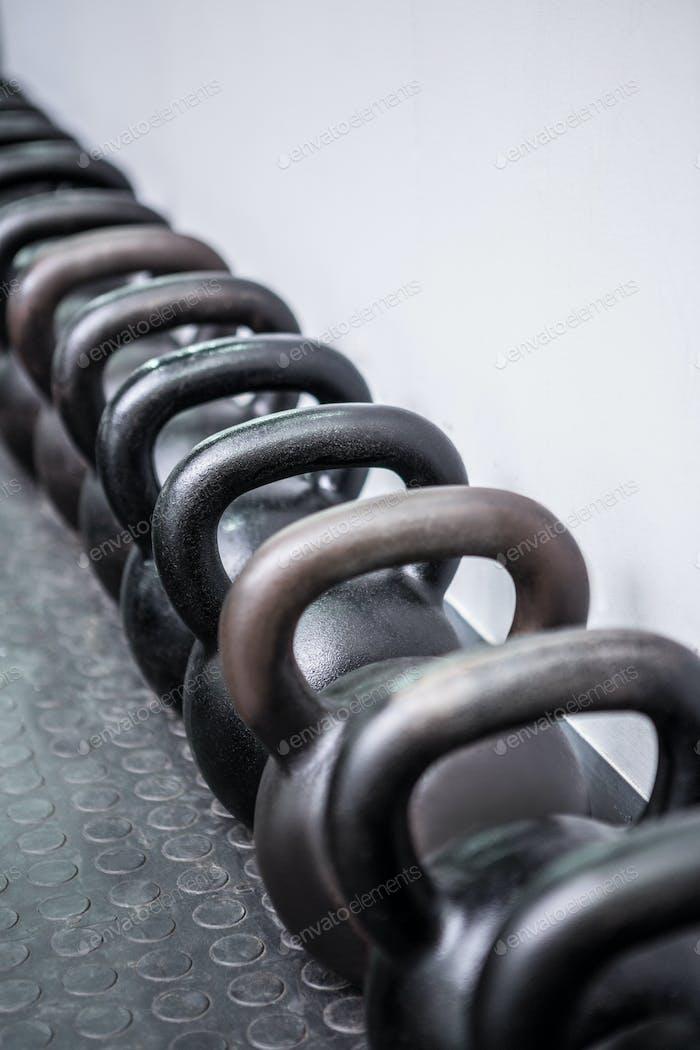 Kettlebells in a row in crosssfit gym