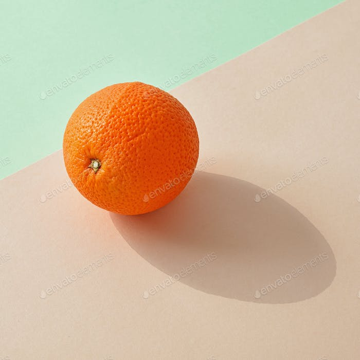 fresh orange on colorful background