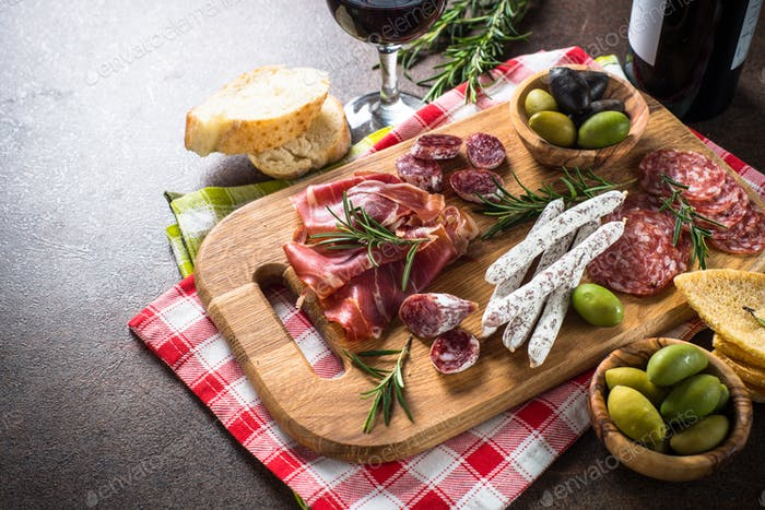 Antipasto delicatessen - sliced meat, ham, salami, olives on woo