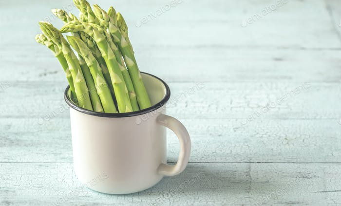 Bunch of fresh asparagus in the mug
