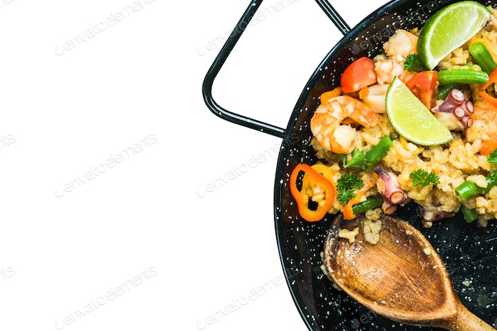 Traditional spanish paella isolated on whte