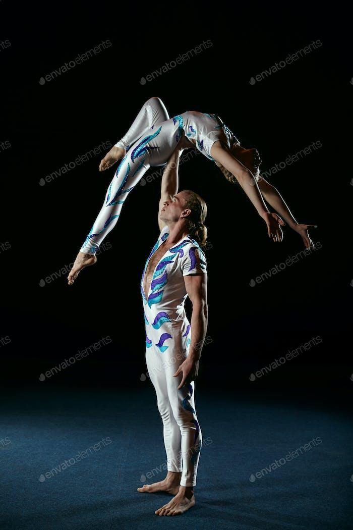 Circus artists perform different tricks
