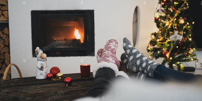 Relaxing by the fireplace at Christmastime