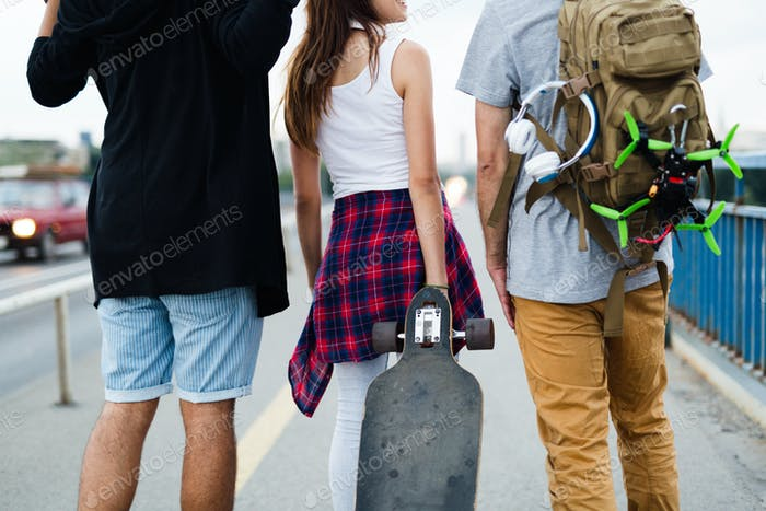 Group of young friends hang out together