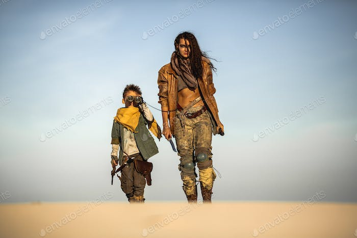 Post Apocalyptic Woman and Boy Outdoors in the Wasteland