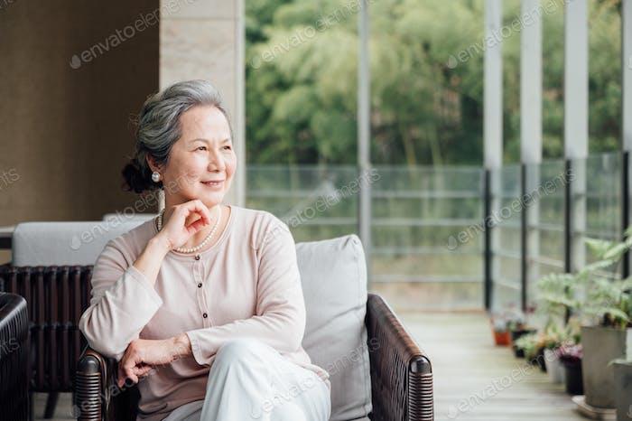 Senior woman sitting on the balcony