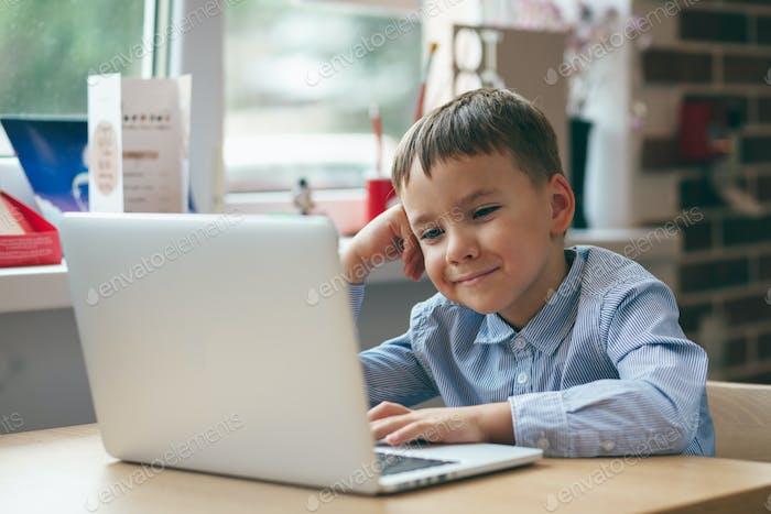 Boy focused on laptop