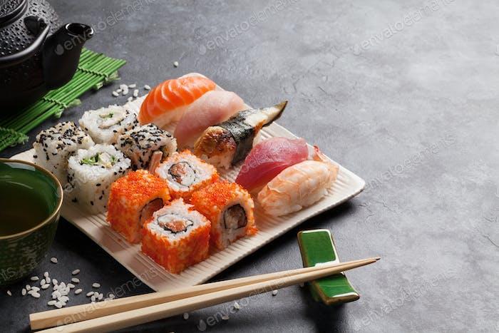 Set of sushi, maki and green tea