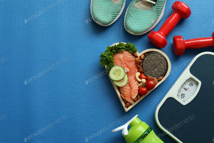 Healthy lifestyle concept on fitness mat background