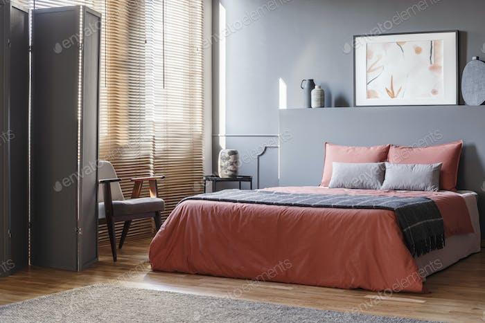 Real photo of elegant bedroom interior with black walls, brown b