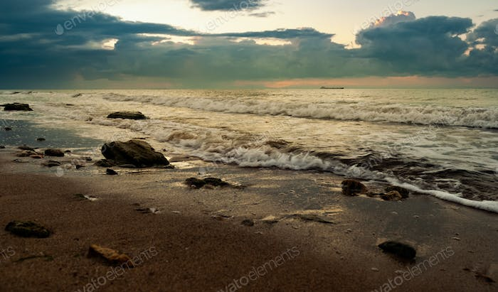 Sandy beach with stones in the morning