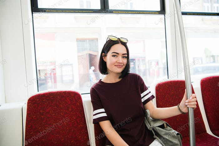 Summer Travel. Portrait Of Happy Smiling Girl In Stylish Sunglasses travelling by bus.