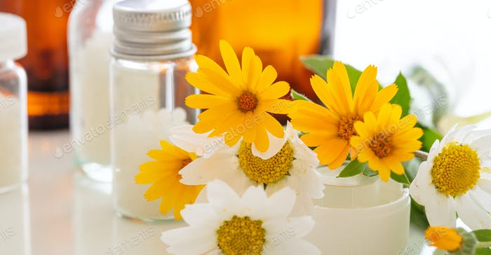 Wild flowers and herbal medicine products closeup view