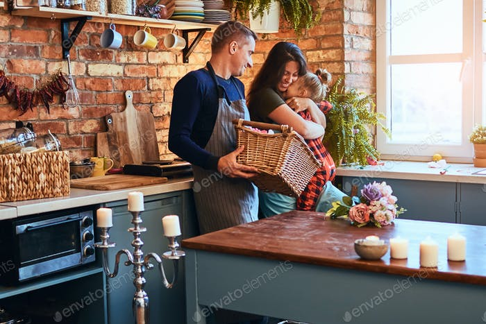 Family in loft style kitchen at morning