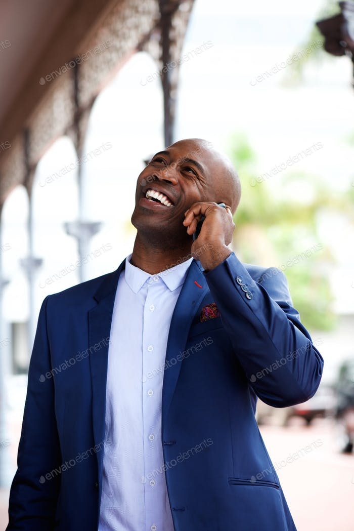 Businessman smiling and talking on mobile phone
