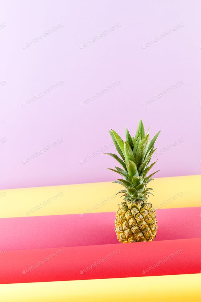 Pineapple on a combined colored background with free space for t