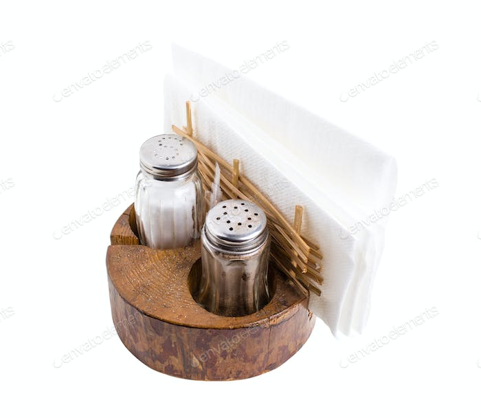 Pepper and salt shakers with napkin holder.
