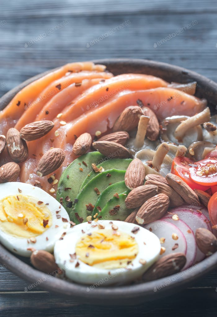 Healthy bowl with salmon, avocado, egg and vegs