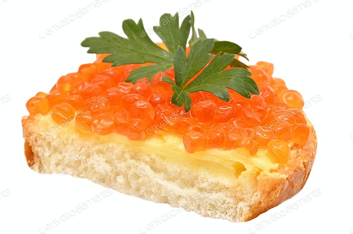 Sandwich with red caviar and parsley