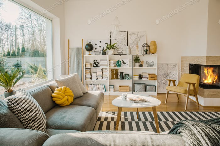 White wooden rack with books, decorations, fresh plants and simp