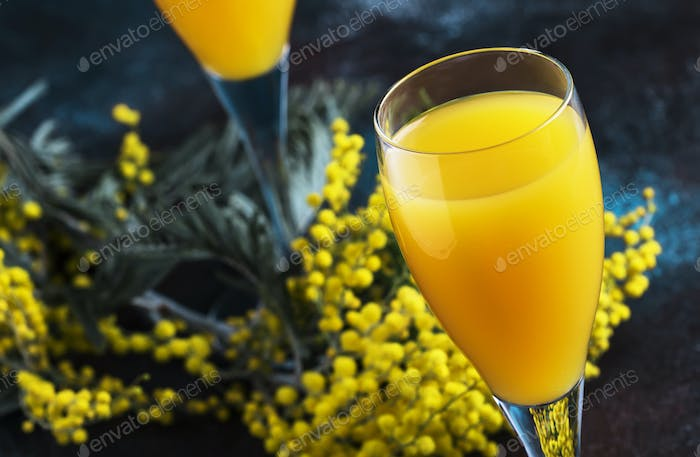 Classic alcohol cocktail mimosa with orange juice and cold dry champagne