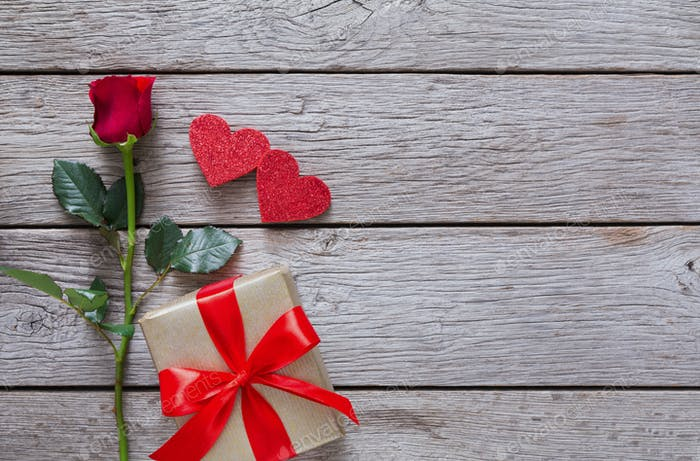 Valentine Background With Red Rose Flower Paper Hearts And Present Box On Rustic Wood