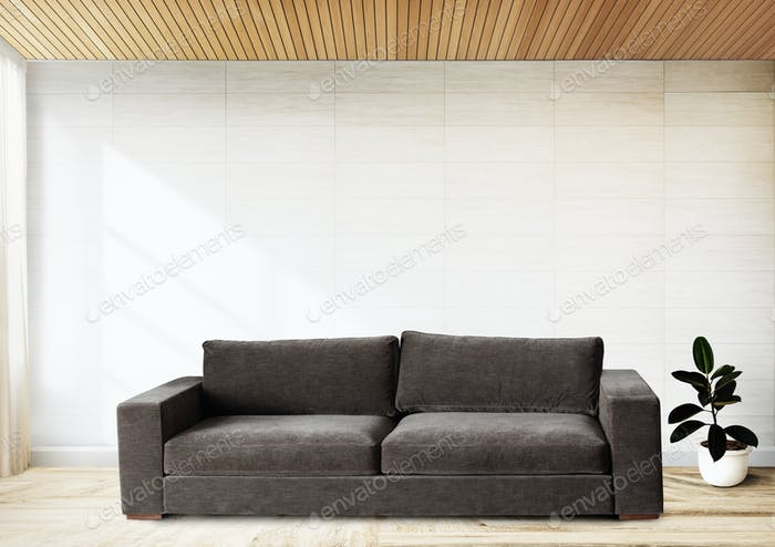 Sofa by a tiled wall