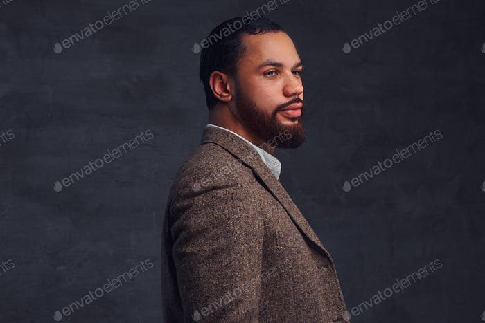 Handsome bearded African-American businessman in a brown classic jacket.