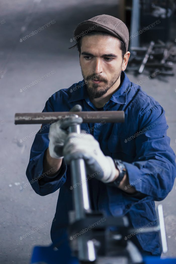 Man holding metal part of bicycle