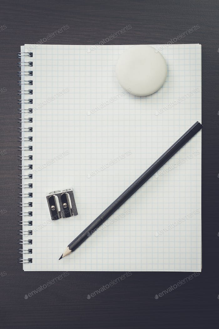 blank notebook and pen on table