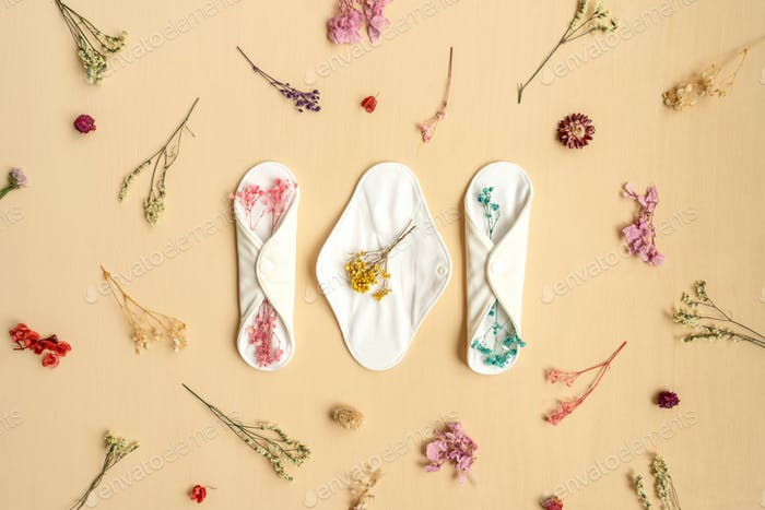 Reusable eco natural pad with flowers.