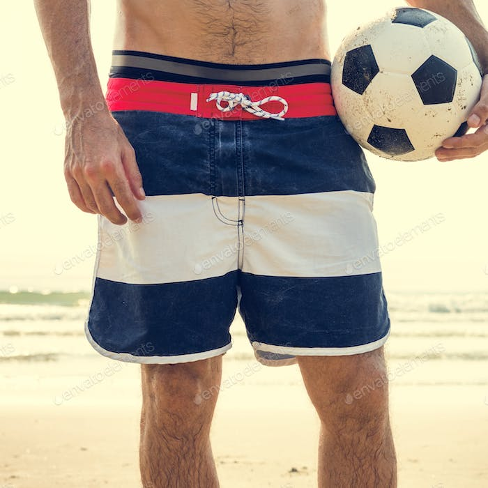 Man Beach Summer Holiday Vacation Football Concept