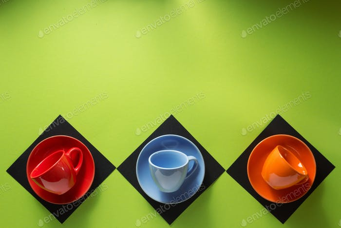 empty cup and saucer at colorful paper