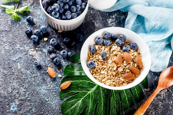 baked granola and berries in bowl