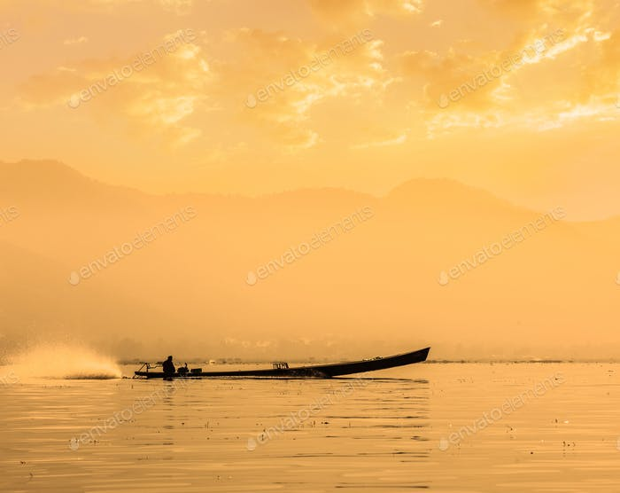 Motor boat silhouette on Inle lake