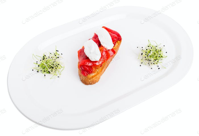 Bruschetta with stewed peppers and mascarpone cheese.