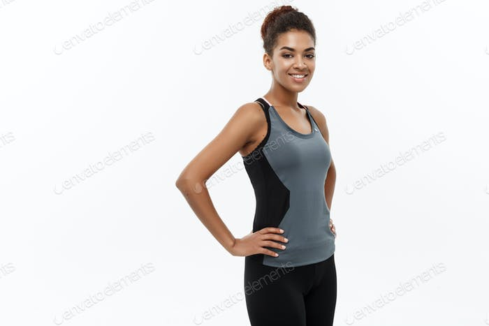 Healthy and Fitness concept - Beautiful American African lady in fitness clothes ready for workout