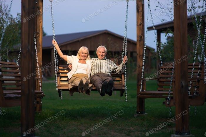 Elderly couple on porch swing