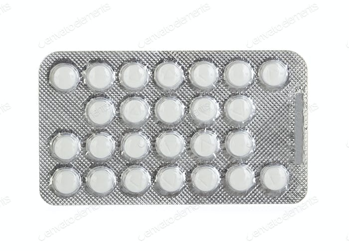 Pills in blister packs isolated on white background