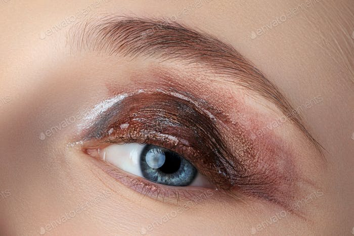 Close up shot of female eye with fashion makeup