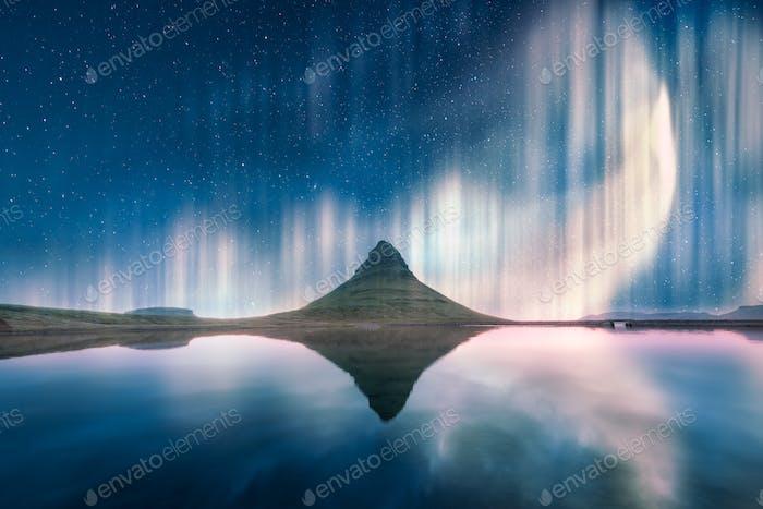 Green aurora light behind Kirkjufell mountain