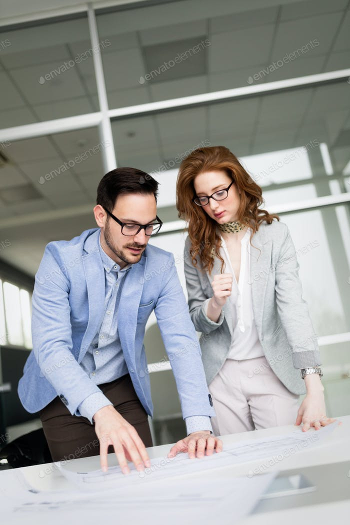 Business coworkers discussing new ideas and brainstorming in a modern office