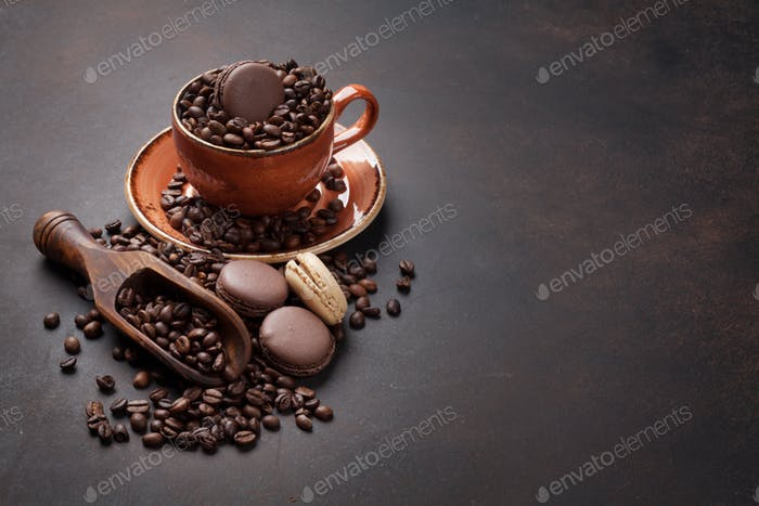 Coffee cup, beans, macaroons