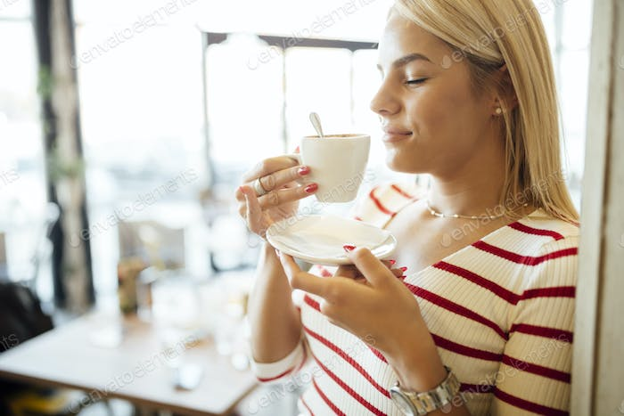 Portrait of a beautiful woman drinking coffee